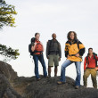 Friends hiking on rocky terrain — Stock Photo