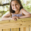 Young Hispanic girl smiling outdoors — Stok fotoğraf