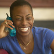 Young woman laughing on the phone — Stock Photo