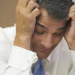 Businessman resting his head in his hands — Stock Photo #23244752