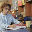 Businesswoman writing at a counter — Stock Photo