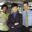 Three businesspeople in office — Stock Photo