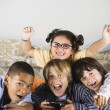 Group of children playing video games — Stock Photo