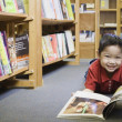 Young boy smiling at bookstore — Stock Photo