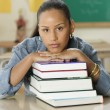 Female Dominican teenager at her desk in classroom — Stockfoto