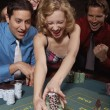 Stock Photo: Womsuccessfully gambling in casino