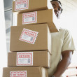 African man carrying returned packages — Stock Photo #23245030