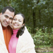 Couple wrapped in a blanket outdoors — Stock Photo