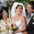Bride posing for the camera with her parents — Stock Photo #23245170