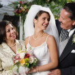 Bride posing for the camera with her parents — Stock Photo