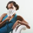 Young woman fanning herself with cash — Foto Stock
