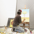 Stock Photo: Male artist painting