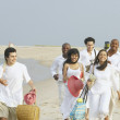 Friends walking on the beach together — Stock Photo