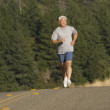 Senior man jogging — Stock Photo