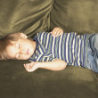 Young boy sleeping on sofa — Foto de Stock