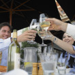 Group of friends toasting at a restaurant — Stock Photo
