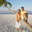 Stock Photo: Couple posing at the beach