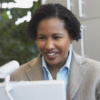 African American businesswoman with laptop — Stock Photo #23245684
