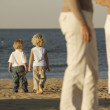 Children walking on the beach together — Stock Photo