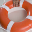 Close up of man's hand holding life preserver — Stock Photo
