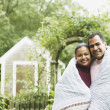 Couple wrapped in a blanket outdoors — Stock Photo #23245882