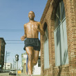Male jogger running in urban surroundings - Stock Photo