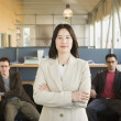 Businesswoman standing in office space — Stock Photo