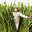 Explorer walking through tall grass — Stock Photo