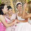 Bride celebrating with her bridesmaids - Stock Photo