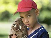 Portrait of boy in baseball cap with mitt — Stock Photo