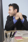 Businessman smiling at his desk — Stock Photo