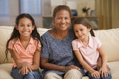 Mother and daughters smiling for the camera together — Stock Photo