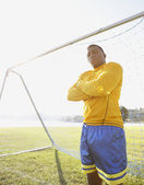 Portrait of goalie standing with arms crossed — Stock Photo