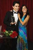 Celebrity couple accepting an award — Stock Photo