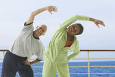 Couple exercising on cruise ship — Stock Photo