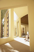 Sunlit lobby of resort hotel — Foto Stock