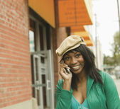 Young woman talking on her cell phone — Stock Photo