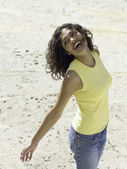 Young woman walking on the beach — Stock Photo
