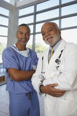 Two middle-aged African doctors — Stock Photo