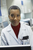 Middle-aged African female doctor smiling — Stock Photo