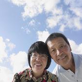 Close up of senior Asian couple outdoors — Stock Photo
