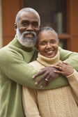 Senior African couple hugging — Stock Photo
