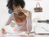 Female employee working behind the counter — Stock Photo