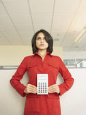 Businesswoman holding a calculator — Stock Photo