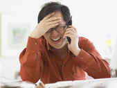 Businessman talking on the phone at his desk — Stock Photo