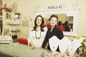 Two businesswomen behind the counter at a boutique — Stock Photo