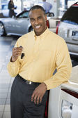Car salesman smiling — Stock Photo