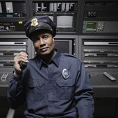 Security guard sitting at control station — Stock Photo