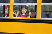 Young Asian girl on school bus — Stock Photo