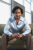 African American businesswoman sitting on sofa — Foto de Stock